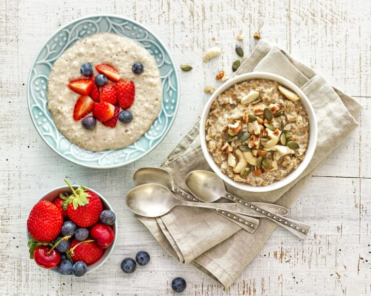 two bowls of various porridge for healthy breakfast, top view